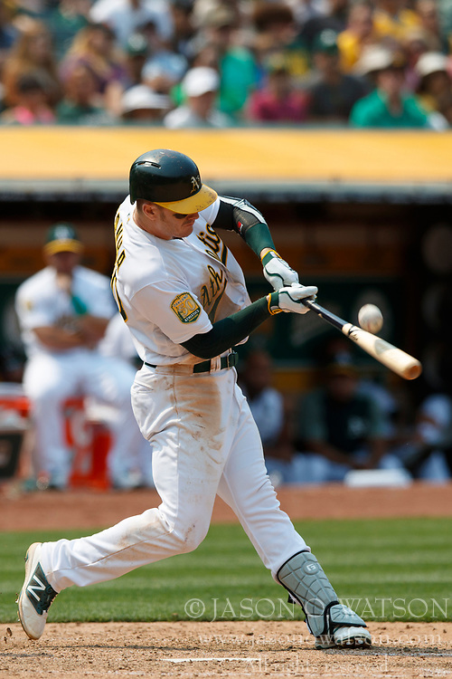 OAKLAND, CA - JULY 01: Mark Canha #20 of the Oakland Athletics at bat against the Cleveland Indians during the seventh inning at the Oakland Coliseum on July 1, 2018 in Oakland, California. The Cleveland Indians defeated the Oakland Athletics 15-3. (Photo by Jason O. Watson/Getty Images) *** Local Caption *** Mark Canha