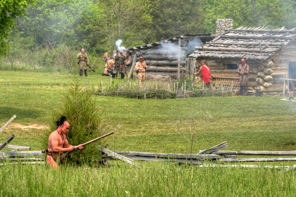 A Native American reenactor reloads his rifle during the raid at the 15th Annual Raid at Martin's Station at Wilderness Road State Park in Ewing, VA on Saturday, May 9, 2015. Copyright 2015 Jason Barnette