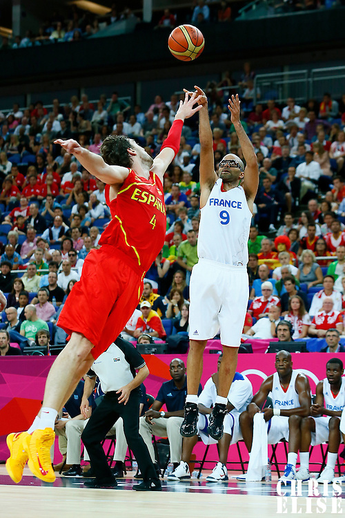 08 August 2012: France Tony Parker takes a three points jumpshot over Spain Pau Gasol during 66-59 Team Spain victory over Team France, during the men's basketball quarter-finals, at the 02 Arena, in London, Great Britain.