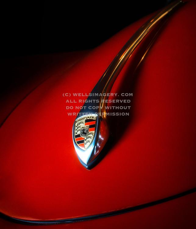 Image detail of a Red 1958 Porsche Speedster with hood crest in Seattle, Washington, Pacific Northwest