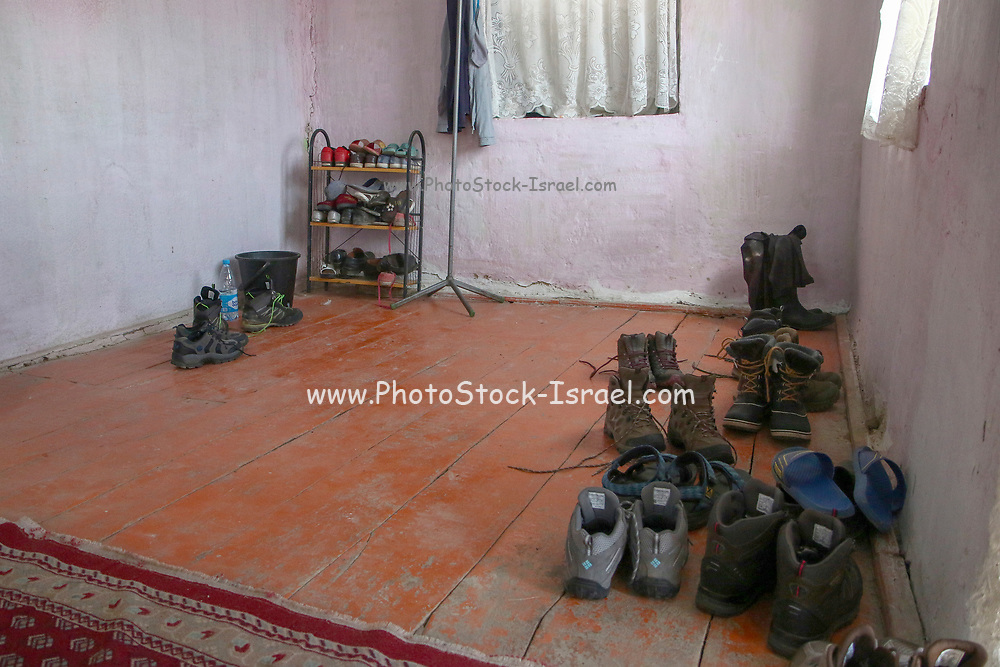 Kyzyl-Oi village (red village or red bowl), Kyrgyzstan. Shoes are left at the entrance to the home to