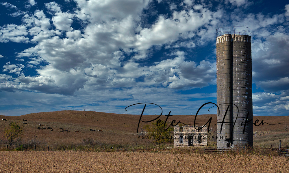 An old stone farm house and silo in the Tall Grass Prairie, in the Flint Hills of Kansas.
