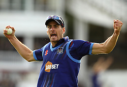 Gloucestershire's Benny Howell celebrates taking the catch of Sam Curran of Surrey CCC wicket - Mandatory byline: Robbie Stephenson/JMP - 07966 386802 - 19/09/2015 - Cricket - Lord's Cricket Ground - London, England - Gloucestershire CCC v Surrey CCC - Royal London One-Day Cup Final