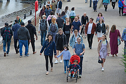 © Licensed to London News Pictures 29/08/2021. <br /> London, UK. People out and about on a cloudy but bright weather day walking along the Southbank in London. Photo credit:Grant Falvey/LNP