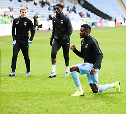 Coventry City's Bright Enobakhare warms up ahead of the Sky Bet League One match against AFC Wimbledon at the  Ricoh Arena, Coventry