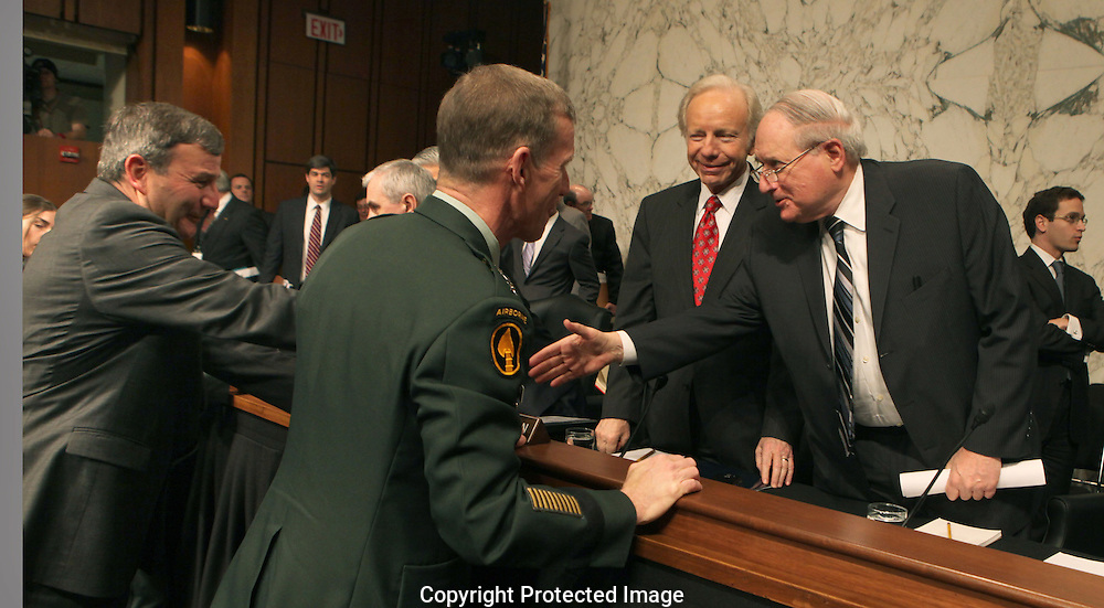 Ambassador Karl W. Eikenberry, US Ambassador  to Afghanistan and General Stanley A. McChrystal commander, International Security Assistance Forces and commander U.S. Forces in Afghanistanshakes hands with Chairman Karl Levin and Senator Joe Lieberman I CND MI. at a hearing of the Senate Armed Services Committee on December 8, 2009.  Photograph by Dennis Brack