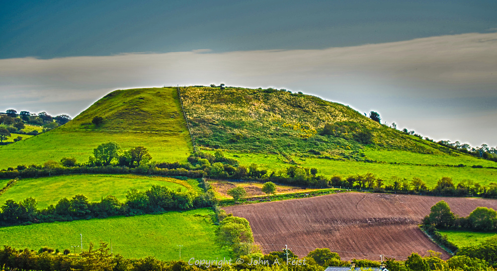 An unusual mound in Cushendall, county Antrim, Northern Ireland.  We couldn't get a good answer about this mound.  It looks like many of the neolithic tombs we saw in other parts of the country.