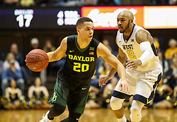 Jan 9, 2018; Morgantown, WV, USA; Baylor Bears guard Manu Lecomte (20) drives past West Virginia Mountaineers guard Jevon Carter (2) during the first half at WVU Coliseum. Mandatory Credit: Ben Queen-USA TODAY Sports