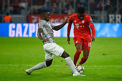 November 6, 2019, Munich, Germany: Mohamed Mady Camara from Olympiacos (L) and Alphonso Davies from Bayern (R) seen in action during the UEFA Champions League group B match between Bayern and Olympiacos at Allianz Arena in Munich. (Credit Image: © Bruno De Carvalho/SOPA Images via ZUMA Wire)