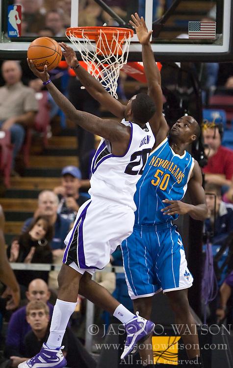 November 29, 2009; Sacramento, CA, USA;  Sacramento Kings forward Donte Greene (20) shoots past New Orleans Hornets center Emeka Okafor (50) during the first quarter at the ARCO Arena. Sacramento defeated New Orleans 112-96.
