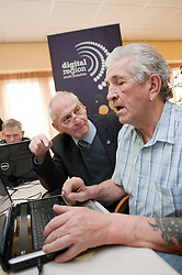 Digital Region Co-Running a series of workshops to equip the elderly with basic computer skills at Bakersfield Court sheltered housing on Longfellow Drive Rotherham- Ron Roberts is helped by Reg Margetts (left)..21 March 2011.Images © Paul David Drabble Digital Region Co-Running a series of workshops to equip the elderly with basic computer skills at Bakersfield Court sheltered housing on Longfellow Drive Rotherham<br /> <br /> 21 March 2011.Images © Paul David Drabble