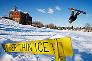 Kevin Bartram   Staff<br /> CCSU student Eric Kren does a backflip while snowboarding over a jump at Stanley Quarter Park in New Britain on Monday. More snow is expected to fall later this week.