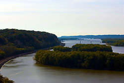 October 2009: View of the Savannah bridge over the Mississippi River, highway 84 and the railroad train tracks from an outlook in the Mississippi Palisades State Park. Sights to see in and around Galena Illinois.