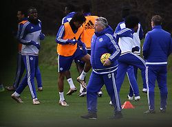© Licensed to London News Pictures. 22/12/2015. London, UK. Chelsea football club interim manager Guus Hiddink (C) takes a training session at the club's Cobham ground. Photo credit: Peter Macdiarmid/LNP