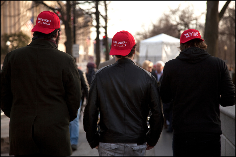 """Trump supporters, wearing Make America Great Again hats, in Washington DC on the eve of the inauguration of Donald J. Trump.<br /> <br /> """"Make America Great Again"""" (MAGA) is a campaign slogan used by Donald Trump in his 2016 presidential campaign."""