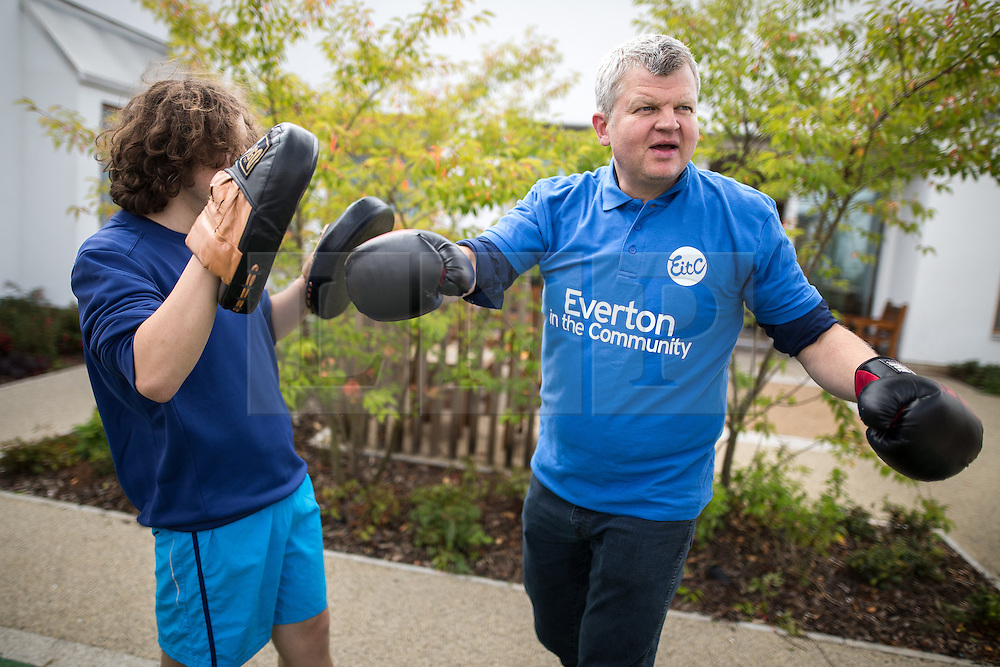 © Licensed to London News Pictures . 11/08/2015 . Merseyside , UK . ADRIAN CHILES boxing with a representative of Everton in the Community . BBC Radio 5 Live broadcast live from Clock View mental health Hospital in Merseyside . Photo credit : Joel Goodman/LNP