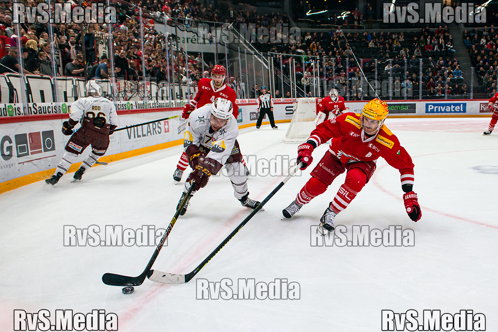 LAUSANNE, SWITZERLAND - NOVEMBER 23: TopScorer #15 Dustin Jeffrey of Lausanne HC battles for the puck with #7 Henrik Tommernes of Geneve-Servette HC during the Swiss National League game between Lausanne HC and Geneve-Servette HC at Vaudoise Arena on November 23, 2019 in Lausanne, Switzerland. (Photo by Robert Hradil/RvS.Media)