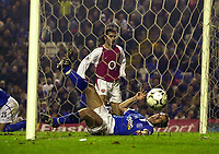 Photo. Glyn Thomas.<br /> Birmingham City v Arsenal. Barclaycard Premiership<br /> St Andrew's Stadium, Birmingham. 22/11/03.<br /> Arsenal's Robert Pires (T) scores his side's third goal, while Matthew Upson is unable to prevent the ball from hitting the back of the net.