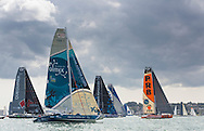 The fleet at the start of the 90th anniversary Rolex Fastnet Race on the Solent. A record fleet of 370 yachts will compete to win the Fastnet Challenge Cup.<br /> The 600 nautical mile race starts in Cowes, Isle of Wight, heading to the Fastnet Rock off the south west coast of Ireland and finishes in Plymouth.<br /> It is the world's biggest offshore race with 75% amateur sailors and professional yachtsmen competing against each other. <br /> Picture date Sunday 16th August, 2015.<br /> Picture by Christopher Ison. Contact +447544 044177 chris@christopherison.com
