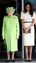 Queen Elizabeth II and the Duchess of Sussex observe a moment of silence in memory of the victims of the Genfell Tower fire during their visit to Storyhouse Chester.