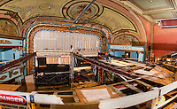 Bonnette, Page and Stone crews work to take out the upper balcony bar joists in the Colonial Theater on Wednesday morning.  (Karen Bobotas/for the Laconia Daily Sun)