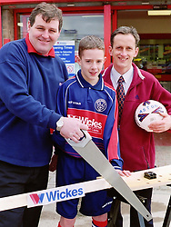 Aston Juniors Under 13s Football club team Captain Danny Hoyland, Manager Ralph Bennett and Wickes Canklow Meadows Store Manager Eddie Fitzpatrick officially reopen the store after its refurbishment on Saturday.<br /><br />COPYRIGHT PAUL DAVID DRABBLE