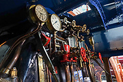 Train valves and meters. The popular National Railway Museum (NRM) tells the story of rail transport in Britain and houses historically significant artifacts, rolling stock, and over 100 locomotives. Visit it in York, North Yorkshire, England, United Kingdom, Europe. In the 1800s, York became a hub of the British railway network.