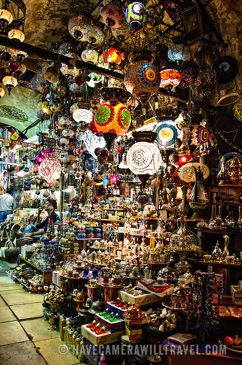 A store selling a variety of small items like lights, tea sets, water pipes, and other items in the heart of Istanbul's historic Grand Bazaar