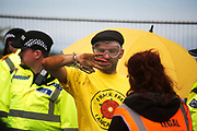 12 local activists locked themselves in specially made arm tubes to block the entrance to Quadrillas drill site in New Preston Road, July 03 2017, Lancashire, United Kingdom. Dan Huxley-Blyth hurt in the process of being cut loose.  The 13 activists included 3 councillors; Julie Brickles, Miranda Cox and Gina Dowding and Nick Danby, Martin Porter, Jeanette Porter,  Michelle Martin, Louise Robinson,<br /> Alana McCullough, Nick Sheldrick, Cath Robinson, Barbara Cookson, Dan Huxley-Blyth. The blockade is a repsonse to the emmidiate drilling for shale gas, fracking, by the fracking company Quadrilla. Lancashire voted against permitting fracking but was over ruled by the conservative central Government. All the activists have been active in the struggle against fracking for years but this is their first direct action of peacefull protesting. Fracking is a highly contested way of extracting gas, it is risky to extract and damaging to the environment and is banned in parts of Europe . Lancashire has in the past experienced earth quakes blamed on fracking.