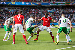 PARIS, FRANCE - Saturday, June 25, 2016: Wales' Ashley Williams in action against Northern Ireland's Oliver Norwood during the Round of 16 UEFA Euro 2016 Championship match at the Parc des Princes. (Pic by Paul Greenwood/Propaganda)