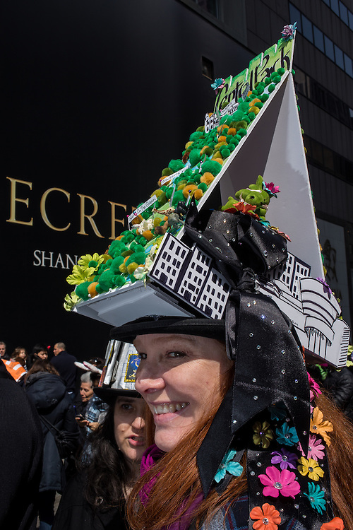 New York, NY, USA-27 March 2016. A woman with a tall hat with a 3-D rendering of Central Park in the annual Easter Bonnet Parade and Festival.