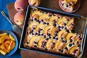 Nashville food photographer Rodney Bedsole buttermilk cake with peaches and blueberries