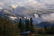 Sun shines on the snow covered hills off of Highway 20, or the North Cascades Highway, in Skagit County. (Erika Schultz / The Seattle Times)