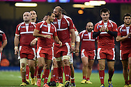 Georgia's scrum-half Giorgi Begadze gets a kiss on the head from teammate Giorgi Chkhaidze as they leave the field at end of match. . Rugby World Cup 2015 pool c match, New Zealand v Georgia at the Millennium Stadium in Cardiff, South Wales  on Friday 2nd October 2015.<br /> pic by  Andrew Orchard, Andrew Orchard sports photography.