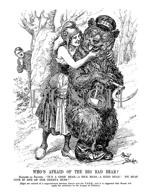 """Who's Afraid of the Big Bad Bear? Madame La France. """" It's a good bear - a nice bear - a kind bear! We must give it one of our Geneva buns!"""" (Signs are noticed for a rapprochement between France and the U.S.S.R., and it is suggested that Russia will apply for admission to the League of Nations.)"""