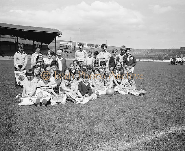 A group of children sitting on the pitch during their visit to Croke Park during a Kells Educational Tour on the 25th June 1976.