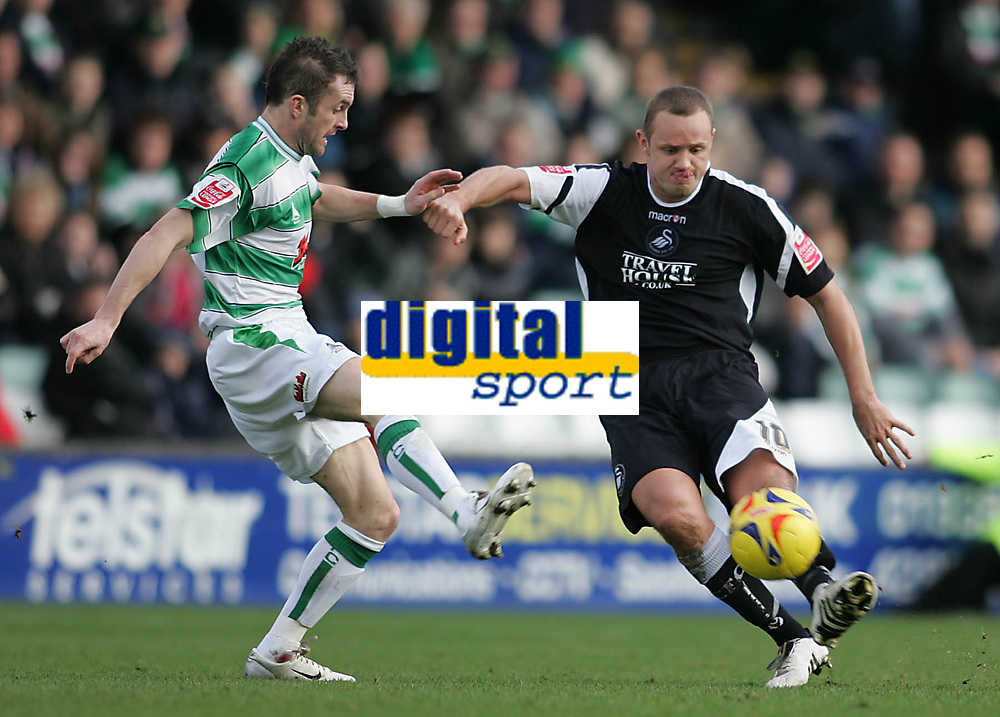 Photo: Lee Earle.<br /> Yeovil Town v Swansea City. Coca Cola League 1. 24/02/2007.Swansea's Lee Trundle (R) holds off Yeovil's Nathan Jones.