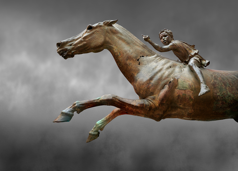 'Jockey of Artrmision' a Hellenistic bronze statue of a boy riding a horse. National Archaeological Museum Athens. Circa 140 BC. Cat No X 15177. Against grey<br /> <br /> Retrieved in pieces from a shipwreck of Cape Artemision in Euboea. The young jockey holds a rein in his left hand and a whip in his right. His face has a passionate expression with furrowas on his face. The pieces of the Bronze sculpture were reassembled in 1971. .<br /> <br /> If you prefer to buy from our ALAMY STOCK LIBRARY page at https://www.alamy.com/portfolio/paul-williams-funkystock/greco-roman-sculptures.html . Type -    Athens    - into LOWER SEARCH WITHIN GALLERY box - Refine search by adding a subject, place, background colour, etc.<br /> <br /> Visit our ROMAN WORLD PHOTO COLLECTIONS for more photos to download or buy as wall art prints https://funkystock.photoshelter.com/gallery-collection/The-Romans-Art-Artefacts-Antiquities-Historic-Sites-Pictures-Images/C0000r2uLJJo9_s0