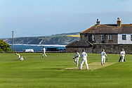 Berwick upon Tweed, Northumberland, England, UK. 27th May 2021. Berwick upon Tweed host nearby Wooler for an evening match overlooking the North Sea. Berwick is the most northern cricket pitch in England.