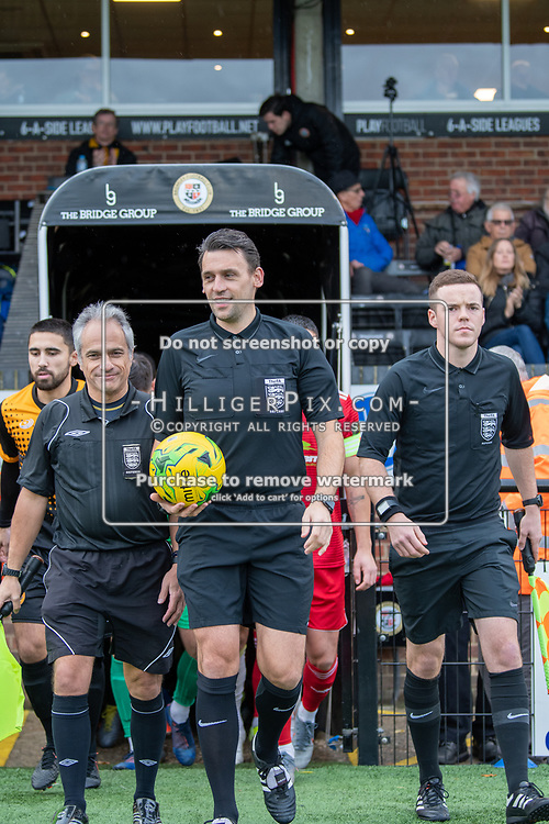 BROMLEY, UK - NOVEMBER 02: The match officials lead the teams out before the BetVictor Isthmian Premier League match between Cray Wanderers and Worthing at Hayes Lane on November 2, 2019 in Bromley, UK. <br /> (Photo: Jon Hilliger)