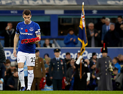 Everton's Seamus Coleman lays a wreath of poppys in remembrance of Armistice Day before the game