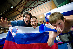 Slovenian fans celebrating victory after the basketball match at 1st Round of Eurobasket 2009 in Group C between Slovenia and Serbia, on September 08, 2009 in Arena Torwar, Warsaw, Poland. (Photo by Vid Ponikvar / Sportida)