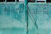 metal door with graphic lettering text to a photo studio