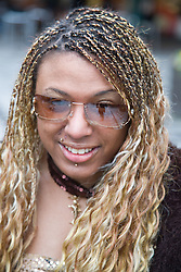 Portrait young woman with Cerebral Palsy wearing sunglasses,