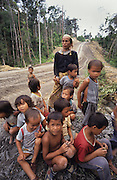 1991: Kenyah native people. Lun wearing traditional brass earrings with many children, at a blockade protest site across a logging road. In 1991/2, the Long Geng and Long Lewan communities made a continuous human blockade for two years, rotating people every two weeks, blocking logging in their traditional lands. Belaga district, Sarawak, Borneo<br /> <br /> Tropical rainforest and one of the world's richest, oldest eco-systems, flora and fauna, under threat from development, logging and deforestation. Home to indigenous Dayak native tribal peoples, farming by slash and burn cultivation, fishing and hunting wild boar. Home to the Penan, traditional nomadic hunter-gatherers, of whom only one thousand survive, eating roots, and hunting wild animals with blowpipes. Animists, Christians, they still practice traditional medicine from herbs and plants. Native people have mounted protests and blockades against logging concessions, many have been arrested and imprisoned.
