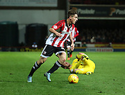 Brentford midfielder Sergi Canos driving into the forest box when Forest wanted a foul in the run up to scoring the winning goal during the Sky Bet Championship match between Brentford and Nottingham Forest at Griffin Park, London, England on 21 November 2015. Photo by Matthew Redman.