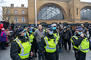 Police arrested a member of the public during an anti-lockdown protest at Kings Cross Station in London, on Saturday Nov 28, 2020. (VXP Photo/ Erica Dezonne)