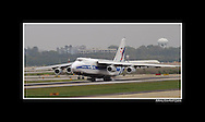 An Antonov AN-124 cargo plane lands at Hartsfield-Jackson Atlanta International Airport to pick up a  Putzmeister concrete pumper,on  Friday, April 8, 2011.  The pump will be delivered to Japan in support of relief efforts following the earthquake and tsunami.  The pump is able to feed water over the destroyed buildings to the exact place of the hotspots within the reactors. In addition, because the pump is operated via radio remote control, the operator is able to remain in a safe location approximately 1.2 miles away while maneuvering the boom pump.  Johnny Crawford ©2011