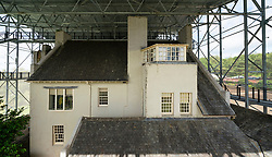 View of Hill House covered with new protective steel mesh Box and walkways to provide shelter from rain to allow house walls to dry out, Helensburgh, Scotland, UK