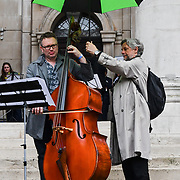 Dash Arts host an anti-Brexit European Flash Mob playing Beethoven's 9th Symphony (Ode to Joy) at Parliament Yard, Westminster Abbey and St John Smith Square ahead of the European Paliament Election on 8 May 2019, London, UK.